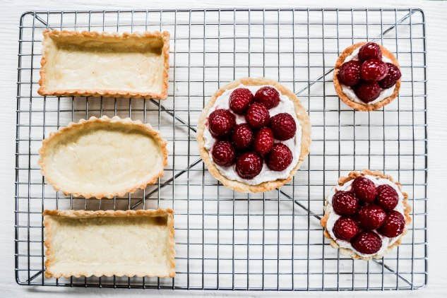 ironstone kitchen - raspberries and raspberry filling into tart shells