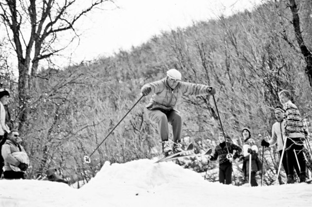 Dad skiing off jump